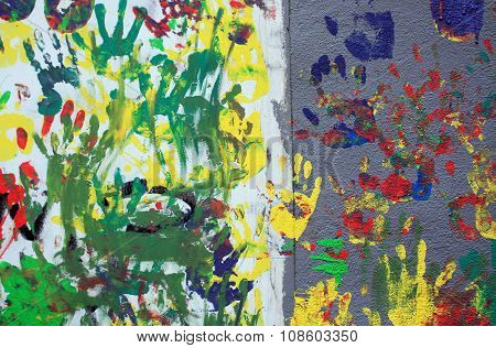 Color Hand Prints On Plaster Wall.