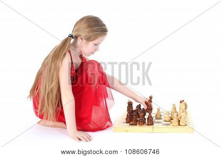 Cute Girl 9 Years Old  Play In Chess On White