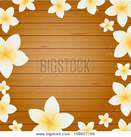 Spa background with frangipani flowers on wooden planks background. Background for web, spa, beauty salon an health center.