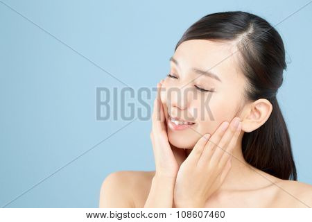 Beautiful asian woman isolated on blue background