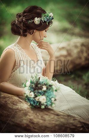 Beautiful bride in white dress in the garden