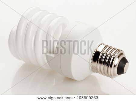 Fluorescent white light bulb on white background.