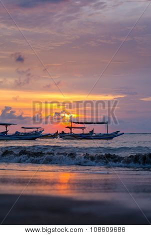 sunrise over fishing boats in Kuta Bali