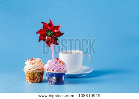 Two Cupcakes On Blue Background With Whirligig