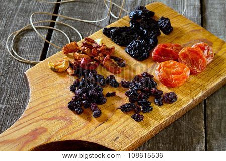 Various Dried Fruits: Apricots, Raisins, Prunes, Dried Apples And Cherries.
