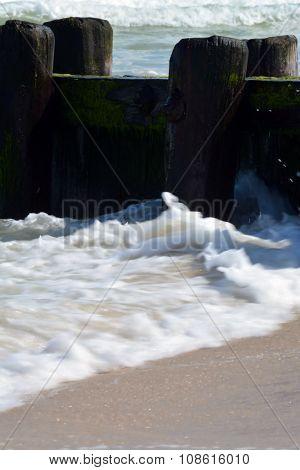 Foamy Waves Along Pier