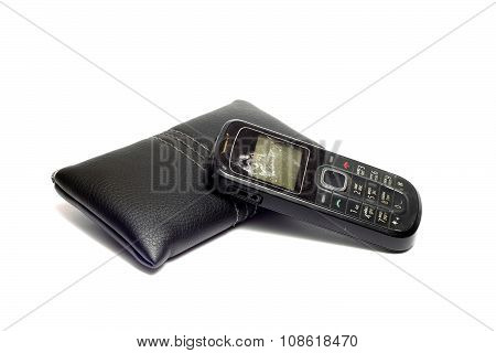 Old, Broken Cell Phone And Leather Case To It