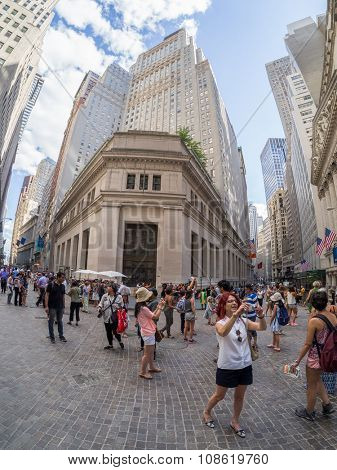 NEW YORK,USA - AUGUST 13,2015 : Tourists in Wall Street at Manhattan's Financial District in New York City