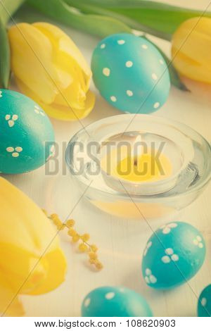Easter Eggs, Candle  And Tulips On White Background