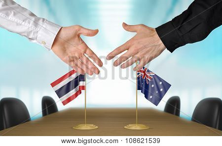 Thailand and Australia diplomats agreeing on a deal