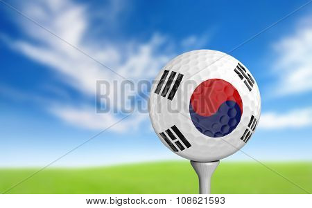 Golf ball with South Korea flag colors sitting on a tee