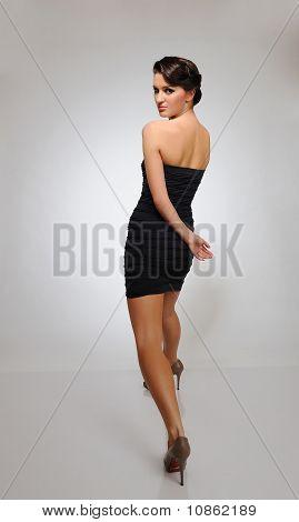 Beautiful Fashion Model Walking On A Catwalk In Studio
