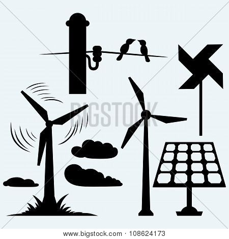 Solar panel and windmill, wires on a pole