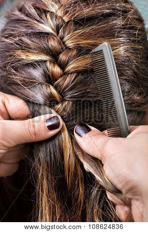 Hairdresser Braiding A Clients Hair