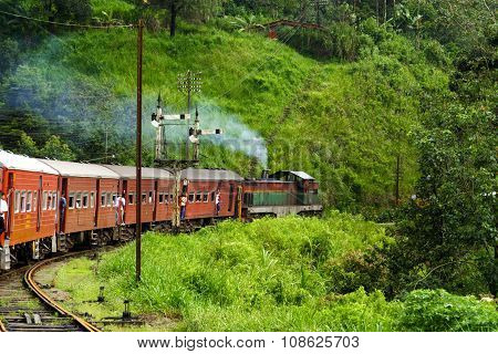 NUWARA ELIYA - SRI LANKA - AUG 3, 2008: riding by train the scenic mountain track from Nuwarelia to Colombo