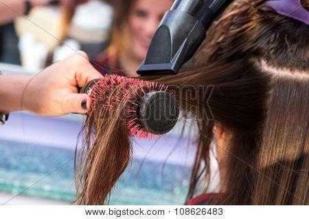 Hairstylist Brushing Hair