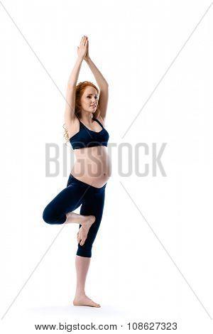 Beautiful pregnant woman in yoga pose