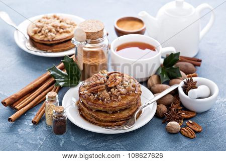Cinnamon and spices pancakes with pecan nuts