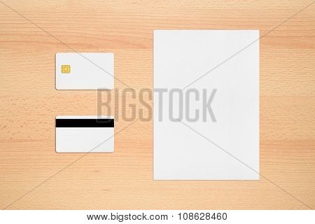 Mock-up Of Credit Card With Two Sides And Paper Sheet On Office Desk