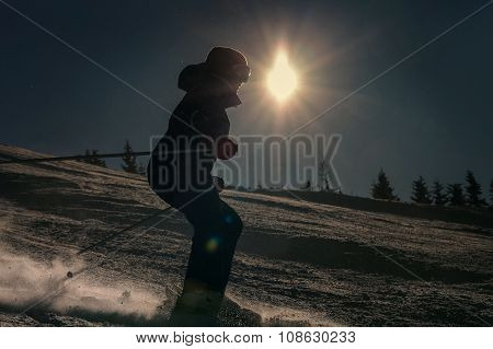 Girl Skier Skate Down On Snow Hill In Sun Backlight