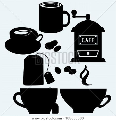 Cups of tea and cappuccino, coffee grinder and a few grains