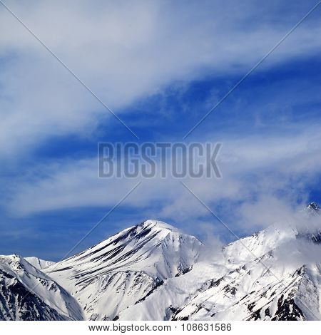 Winter Snowy Mountains And Sky With Clouds At Nice Day