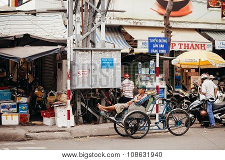 Nha Trang, Vietnam - Circa March 2015 - Unidentified Rickshaw Taxi Driver