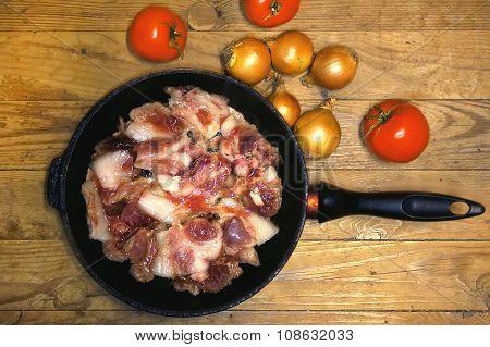 Fresh raw meat in a frying pan