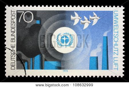 GERMANY - CIRCA 1973: a stamp printed in the Germany shows Environment Emblem and pollution of the Air, Nature and Environmental Protection, circa 1973