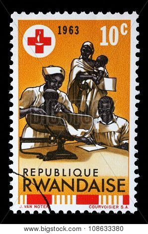 RWANDA - CIRCA 1963: A stamp printed in Rwanda is dedicated to the 100th anniversary of the International Red Cross, circa 1963