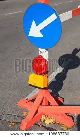 Roadsign With Red Light And White Arrow In Blue Circle