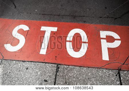 Road Marking With Stop Label Over Red Line