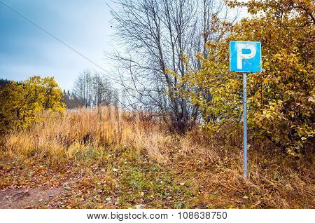 Empty Parking Lot With Roadsign, Finnish Countryside