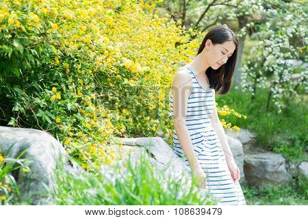 Cute Girl In Colorful Dress Garden