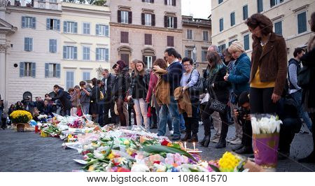 Flowers And Lit Candles In Front Of The French Embassy In Piazza Farnese In Rome