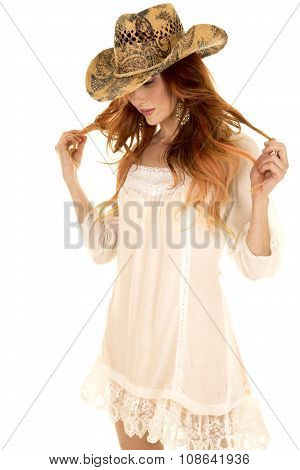 Cowgirl In White Short Dress And Red Hair Look Down