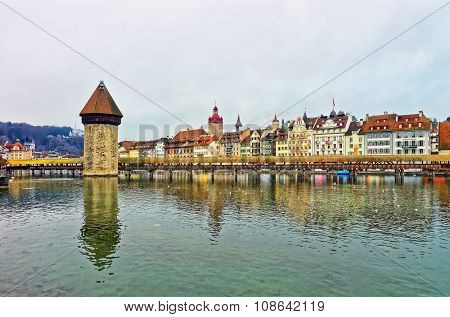 Famous wooden Chapel Bridge in Lucerne Switzerland. Subsequently restored the Kapellbrucke is the oldest wooden covered bridge in Europe as well as the worlds oldest surviving truss bridge