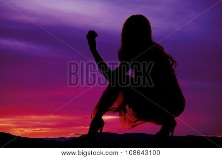 Silhouette Of A Woman In A Dress Down One Knee Up