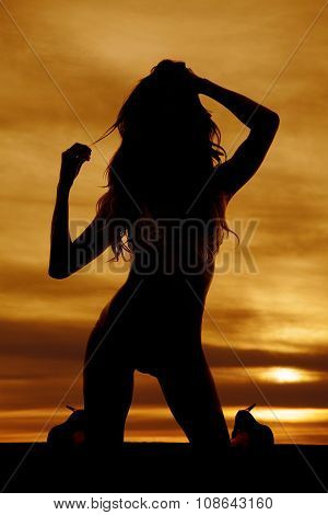 Silhouette Of  Woman  In Bikini On Knees Facing Hand On Head