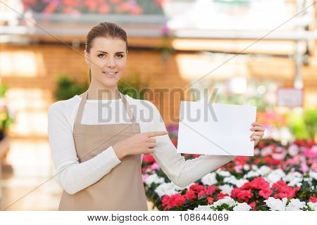 Positive flower seller at work