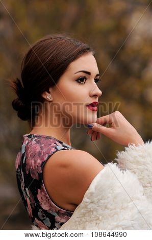 Outdoors Portrait Of Beautiful Young Woman With Big Eyes And Red Lips