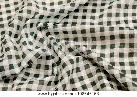 Close Up On Crumpled Checkered Tablecloth Fabric.