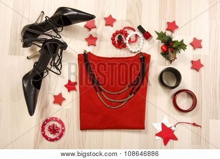 Winter Christmas Sweater With Accessories Arranged On The Floor.