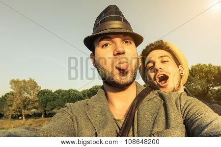 Two Young Hipsters Friends Taking Selfie Outdoor In Holidays - Fashion And Lifestyle Concept - Vinta
