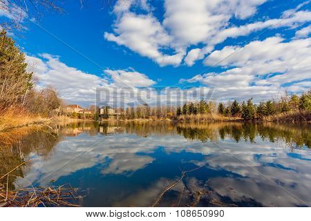 Pond and cloudy sky