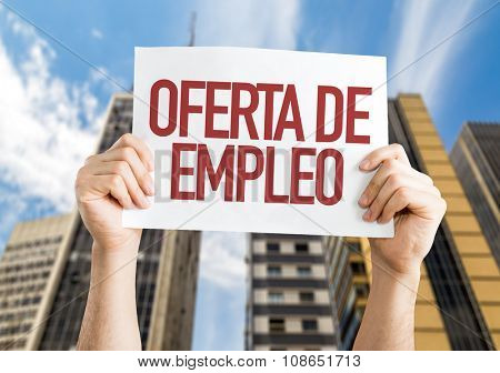 Employment Offer (in Spanish) placard with urban background