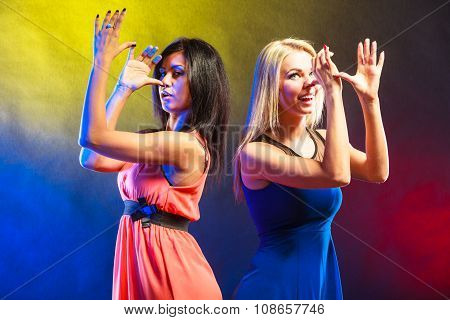 Two Funny Women In Dresses With Hands Gesture.