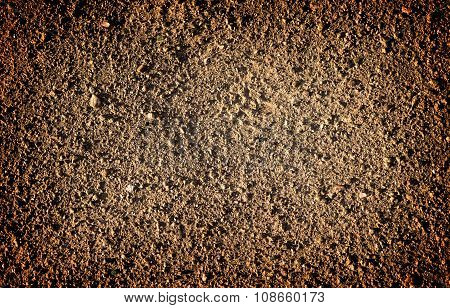 Brown Earth And Gravel Macro Texture Background High Contrasted With Vignetting Effect