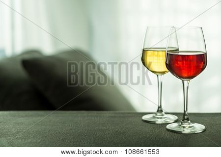 Glasses Of Red And White Wine In A Living Room