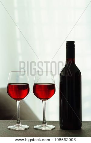 Two Glasses Of Red Wine In A Living Room